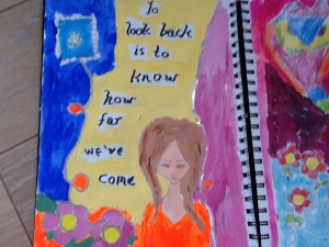 This was my first attempt. The girl in the picture is part of a background by the artist and art journal maker Jennibellie