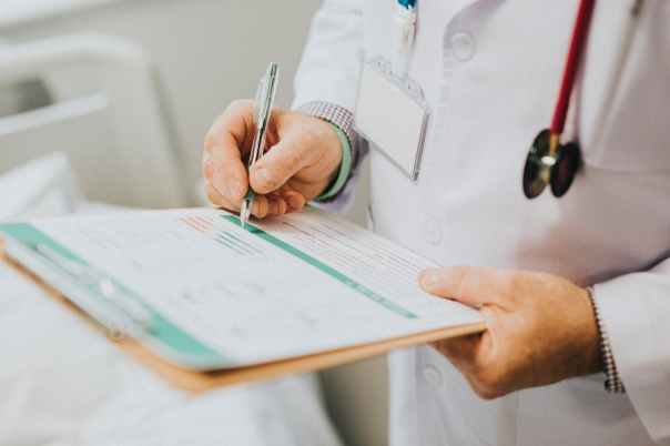 clinician writing medical report